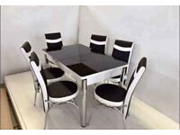 Black and white Extendable glass dining table and chairs