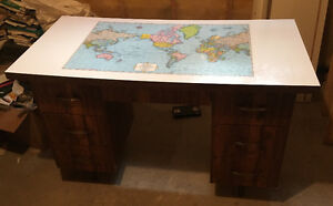 Desk with drawers and world map on the top