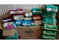Job lot of Nappies/pull ups, pampers huggies mamia and more nappies/pull up pants over 530
