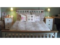 Floral bedding with matching curtains, chandelier and lamps