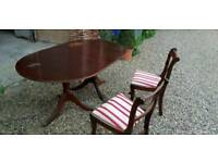Dining table with 6 matching chairs. (Two shown)