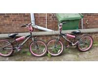 2 x pink and black childrens BMX bikes age 5-12