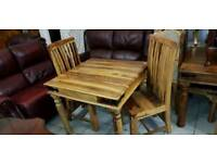 Lovely Indian solid mango wood dining table and 2 chairs.