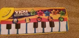 Piano floor mat