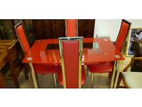 Lovely red glass dining table and 4 chairs, excellent condition
