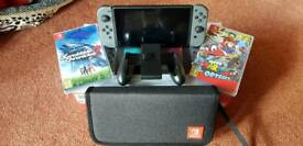 Grey Nintendo Switch - 2 Games and Official Carry Case