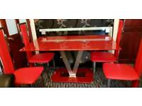 Red dining table with 4 chairs