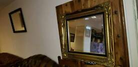 Beautiful gold and black colour frame with quality mirror. Excellent condition