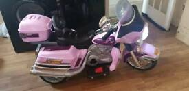 Ride on childs electric bike