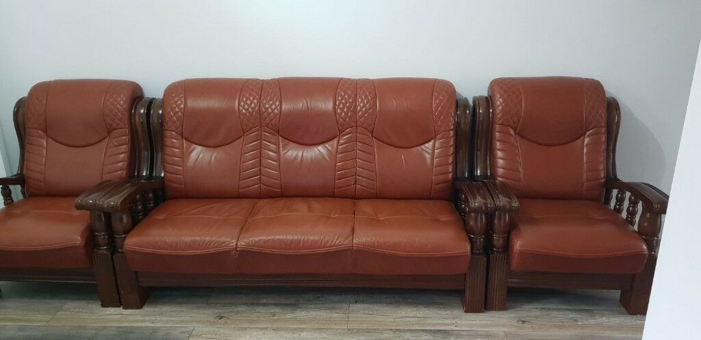 leather tan sofa with wooden arms in leicester leicestershire gumtree. Black Bedroom Furniture Sets. Home Design Ideas