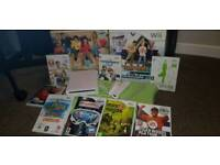 Wii with Wii fit, 8 games and 2 floor mats