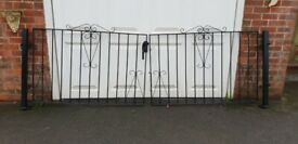 Black decorative wrought iron driveway gates