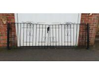 Black decorative wrought iron driveway gates