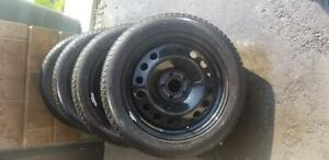 LIKE NEW FORD FOCUS  HIGH PERFORMANCE  MICHELIN   WINTER TIRES 215 / 50 / 17  ON  HUBCENTRIC OEM  QUALITY STEEL RIMS