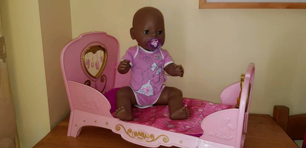 Baby born ethnic doll as new with musical light up bed