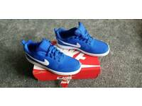 Blue Nike trainers
