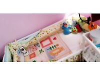 Selling cot with fitting mattress and bedding