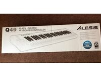 Alesis Q49 USB/MIDI Keyboard. er used.midi/USB cable.