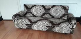 Storage, bed, brown patterned fabric upholstered settee.