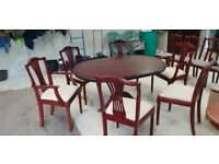 Round extendable dinig table with 6 chairs
