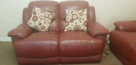 2× two seater red recliner sofa