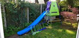 Climbing frame with slide, monkey bars and climbing net