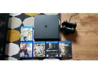 PS4 Slim 500GB + 1 controller + games + charging station