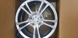 BRAND NEW NEVER MOUNTED 15 INCH ( 5 X 114.3 ) ALLOY WHEEL SET OF FOUR.