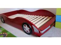 Single car racing bed and mattress, bed needs tlc mattress is like new and about 4 months old