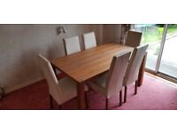Solid wood contemporary dining table and six chairs