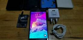 Samsung Note 4 Unlock + 4x Cases + charger+ Wireless Charger Adapter.