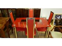 Lovely red glass dining table and 4 chairs ,Excellent condition