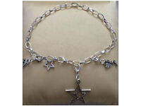 Silver plated Star charm bracelet with Tibetan silver charms