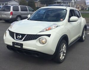 2011 Nissan Juke SV AWD with a Sunroof , Automatic and sport...