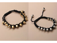 Black corded bracelet with gold or silver coloured spikes - JTY090