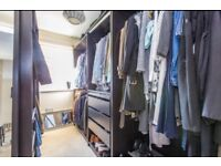 Walk in wardrobe including glass shelves and lights