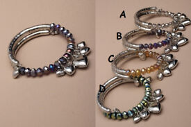 Silver coloured metal snake coiled bracelet with coloured stones and heart dropper charms - JTY135