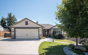 Stunning Rancher with LEGAL SUITE in Scenic Smith Creek