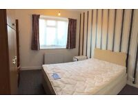 A large double room to let at Denmark Hill south of river Zone 2