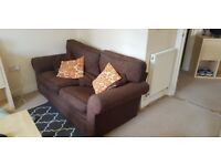 2 Identical 2 Seater Sofas with 6 smaller cusions