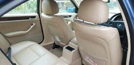BMW 330i with leather interior, sun roof and sports exhaust for sale.