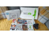 nintendo wii with games and wii fit board all boxed