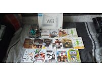 boxed nintendo wii with games and disney infinity figures and portal