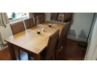 Solid oak dining room table with 4x leather chairs