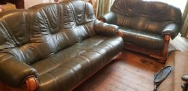 Two beautiful antique greenleather suites