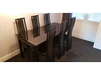 Black Glass extending dining table and 6x high back chairs. £275.