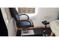 Black leather pedicure chair with stool