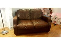 Leather Sofa 3&2 seater with storage foot rest