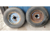 2 used 145 R 10 radial tyres with rims