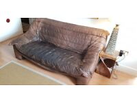 Very old and unusual leather sofa